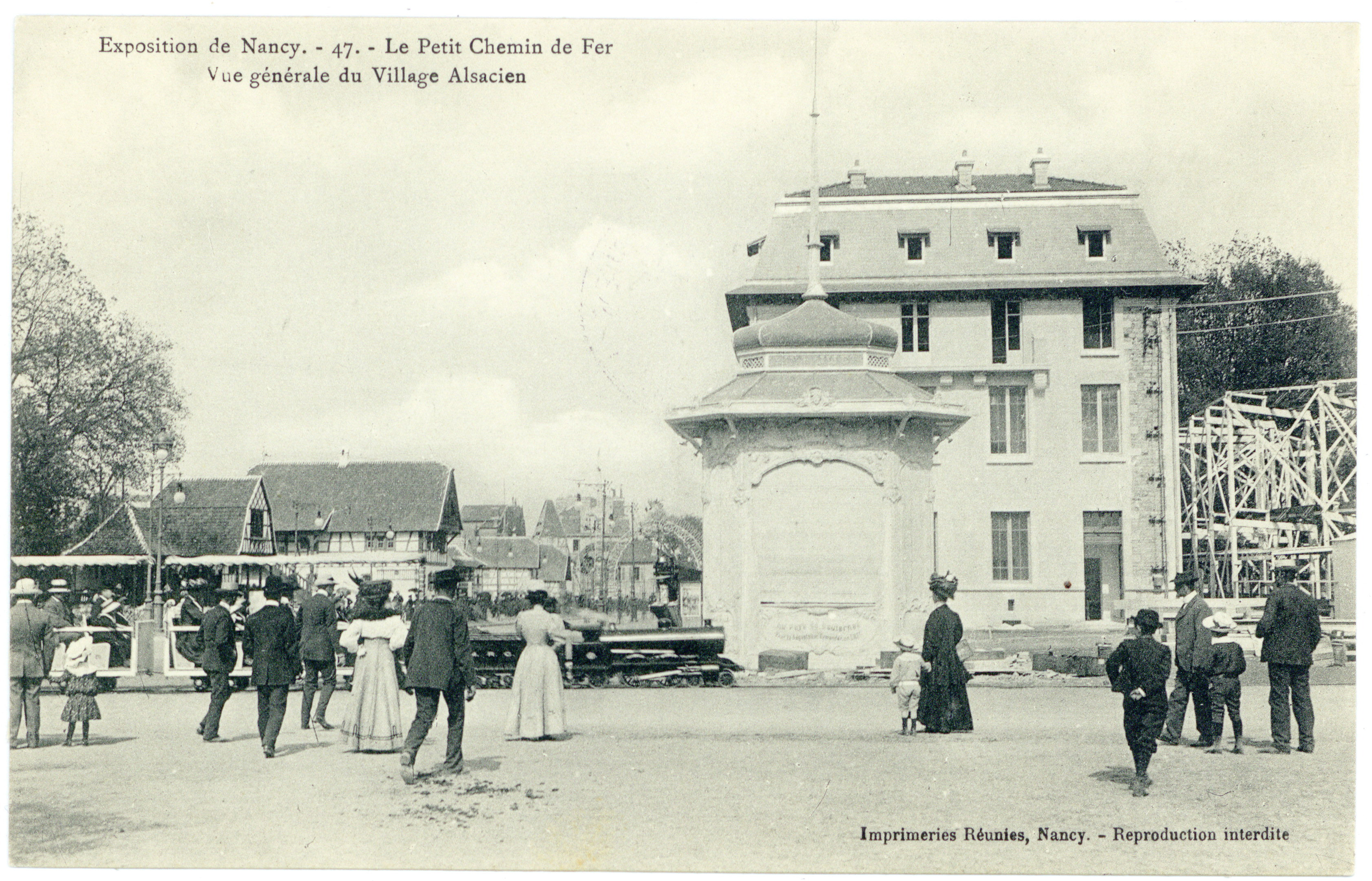 Contenu du Le petit chemin de fer, vue générale du village alsacien : exposition de Nancy