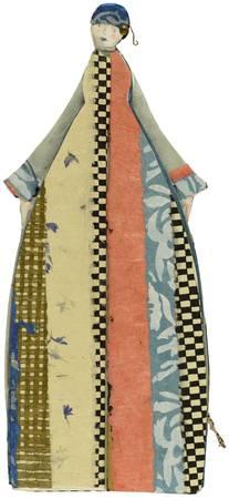 La couturière et sa robe à motifs