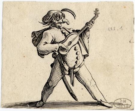Les Gobbi: Le comédien masqué jouant de la guitare