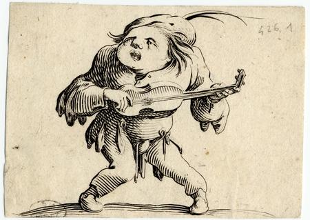 Les Gobbi: La bancal jouant de la guitare