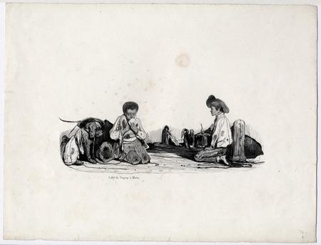 Scène d'enfants de rue jouant aux cartes